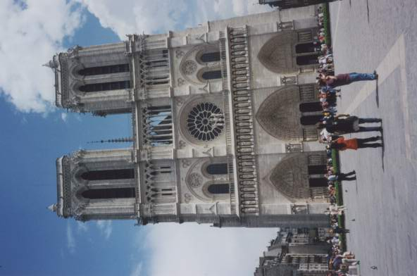 this si the notre dame in paris; it's a very old cathedral. the stained glass window in the center has a special name but i can't remember it. it's very pretty